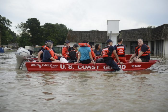 U.S. Coast Guard members rescue locals from flood water on their flat-bottom boats in Baton Rouge, Louisiana, Aug. 14, 2016. The Coast Guard sent water and air assets to assist the victims in the Baton Rouge area. (U.S. Coast Guard photo by Petty Officer 3rd Class Brandon Giles)